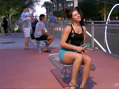 Pretty solo model in a sexy miniskirt pleasures herself while sitting in public