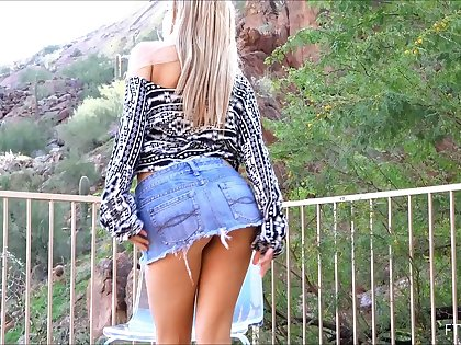 Alluring blonde drops her miniskirt and masturbates wildly in a close up shoot