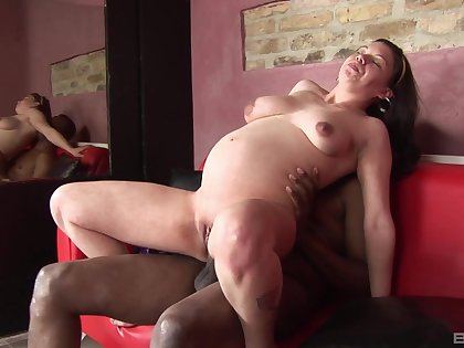Pregnant brunette masturbates before sex with her black lover
