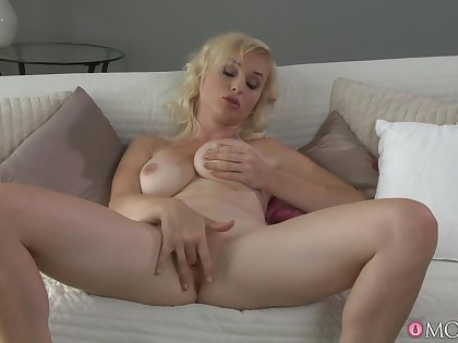 Stacked blonde MILF puts on two hell of a defilement merely